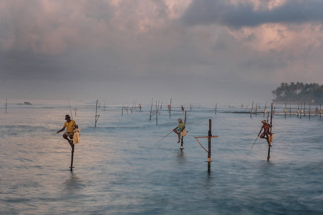 photographer jay dickmans adventurous spirit 12 sri lankan stilt fishermen
