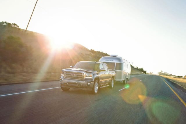 2014 GMC Sierra 1500 4WD in motion with Airstream trailer