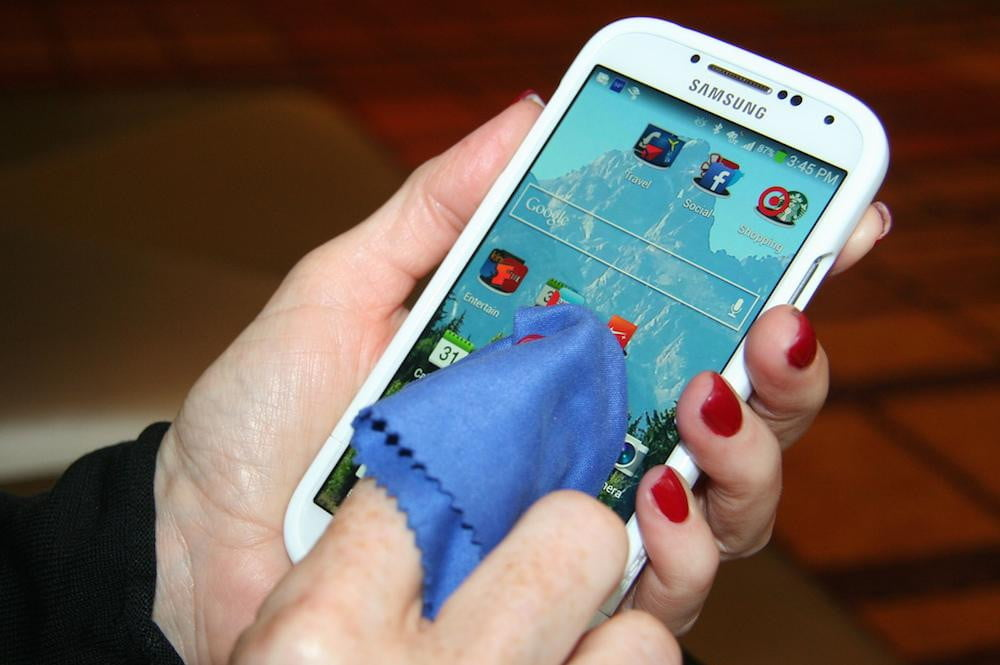 Image result for Someone cleaning smartphone with cloth - hd image
