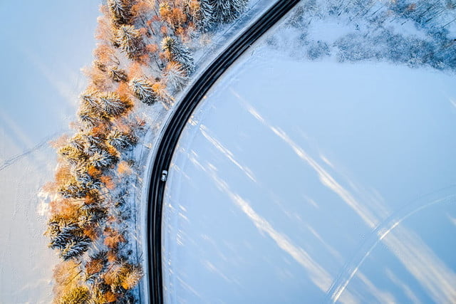 best drone photos aerial shot of picturesque snow covered maridalen  norway on a sunny winter afternoon