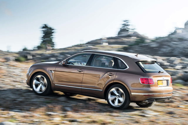bentley says its bentayga suv can do it all but will customers bite  off road rear three quarter 2
