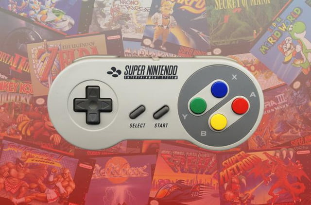 best SNES games SNES controller atop a stack of games