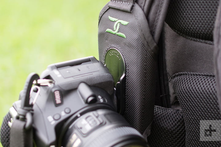 A camera holstered into the Cotton Carrier StrapShot