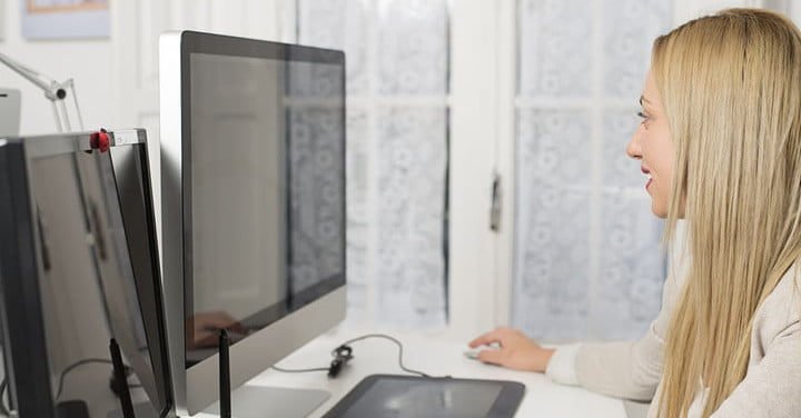 54539108 attractive woman working at the computer and two monitors 2 1200x630 c ar1.91