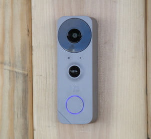 Photo of the doorbell on the wall.