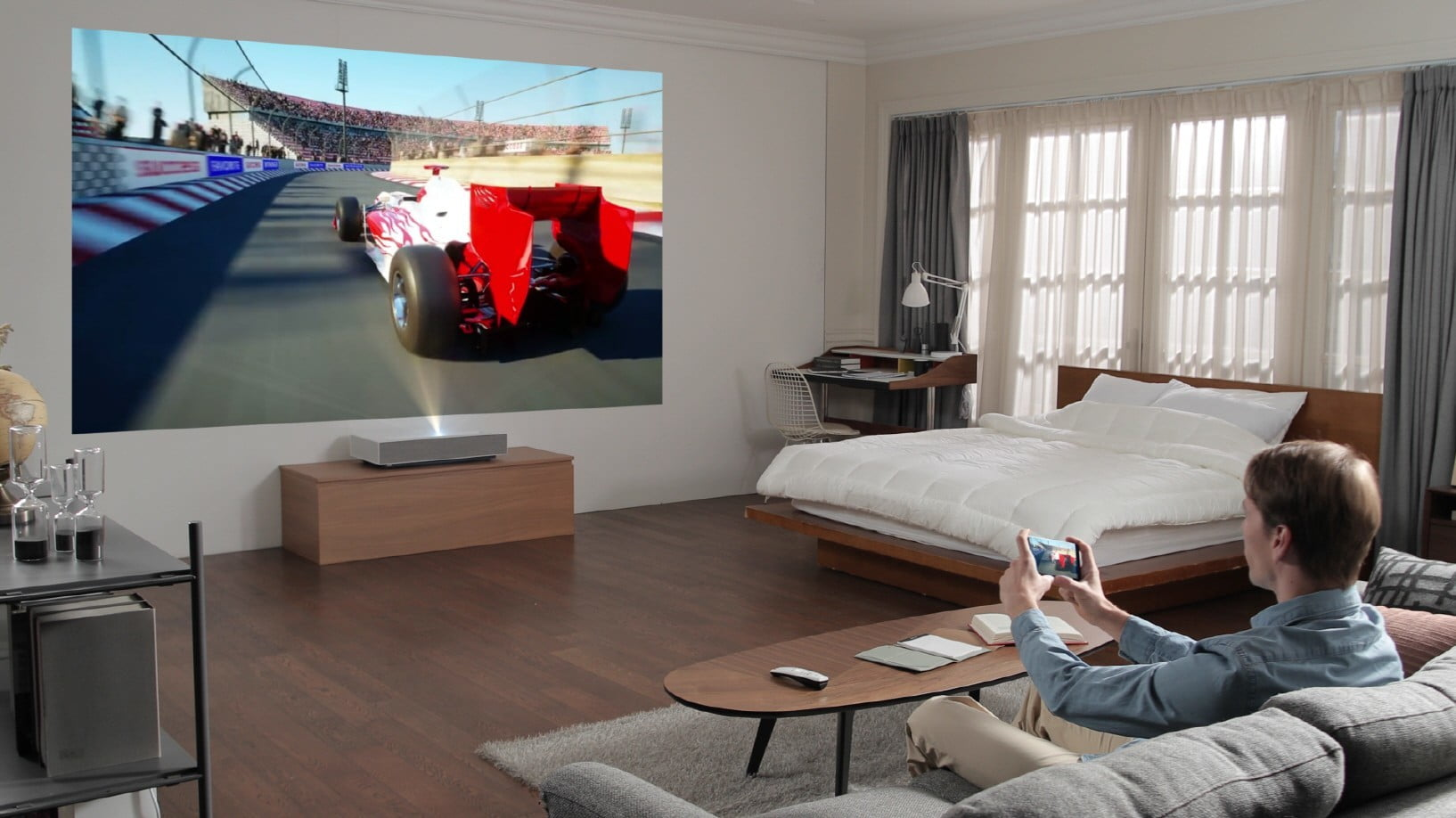LG's new Cinebeam laser projector creates a 90-inch screen from 2 inches away