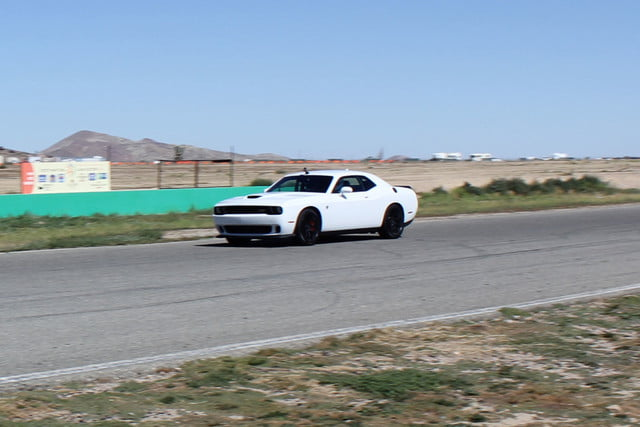 2015 dodge charger challenger srt hellcats track review and hellcat on side angle