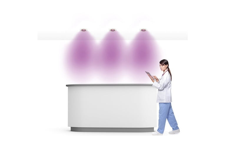 Cleanse Downlight shining on a female doctor
