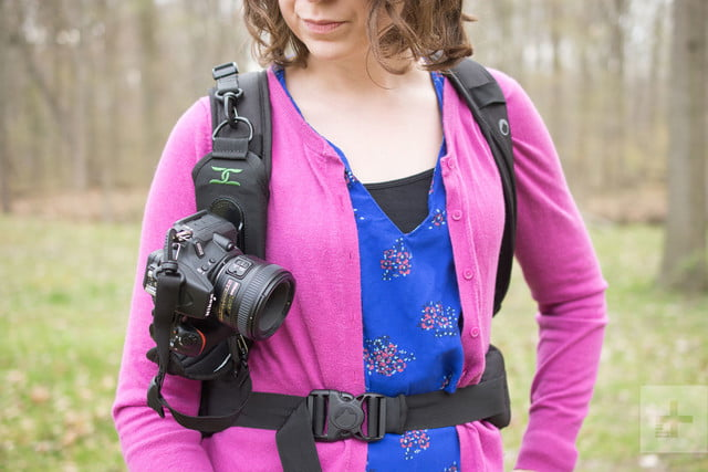 From the front, the Cotton Carrier StrapShot holds a camera in place on a woman