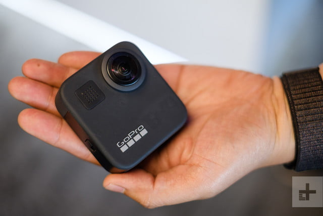 GoPro Max 360 camera in hand, front