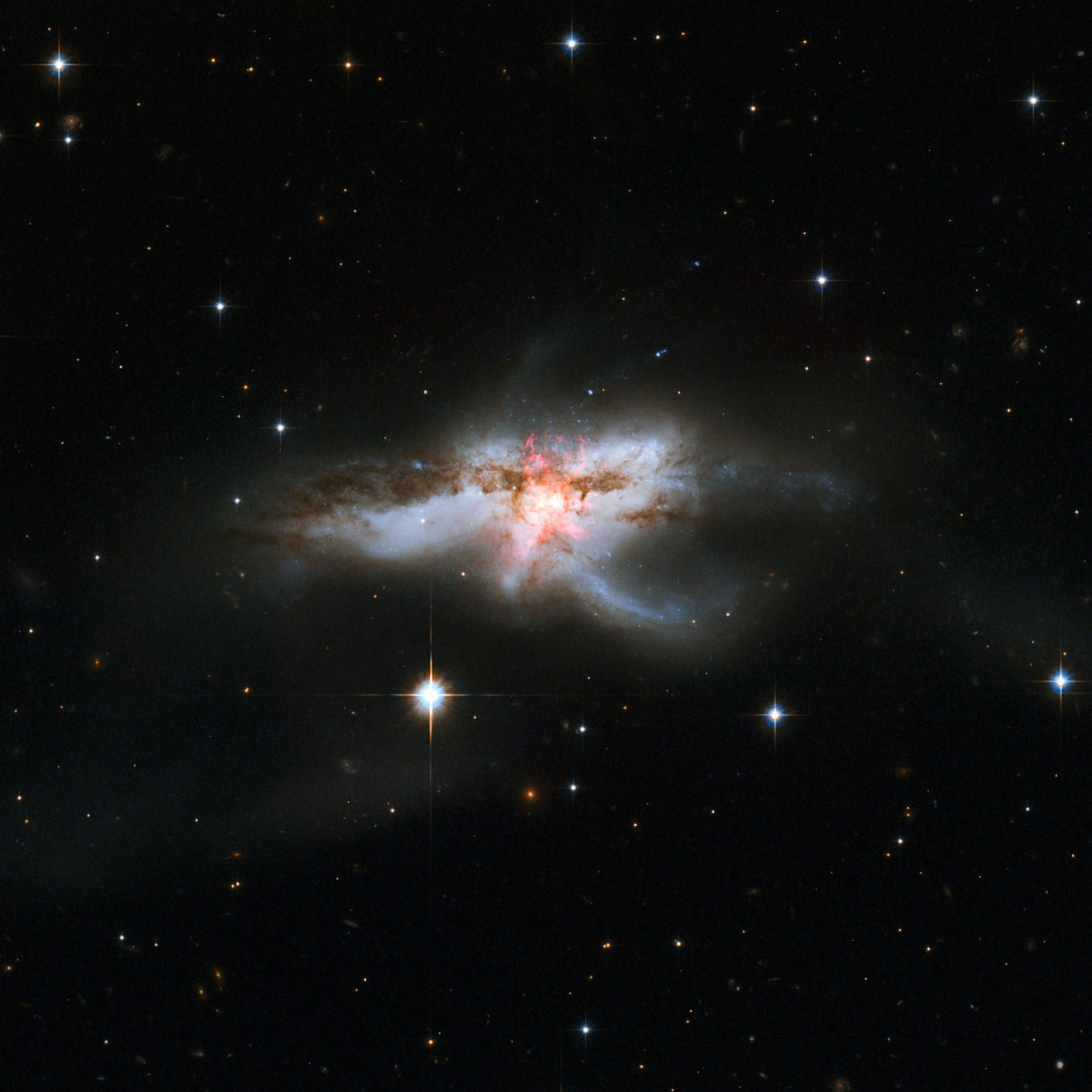 Astronomers find cosmic anomaly: Three supermassive black holes in one galaxy