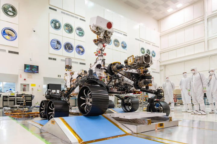 Engineers observe the first test drive for NASA's Mars 2020 Perseverance Rover on December 17, 2019 in a clean room in NASA's Jet Propulsion Laboratory in Pasadena, California.