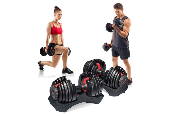 man and woman with selecttech dumbbells
