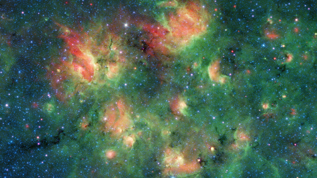 Spitzer Space Telescope sees cosmic bubbles forming around young stars