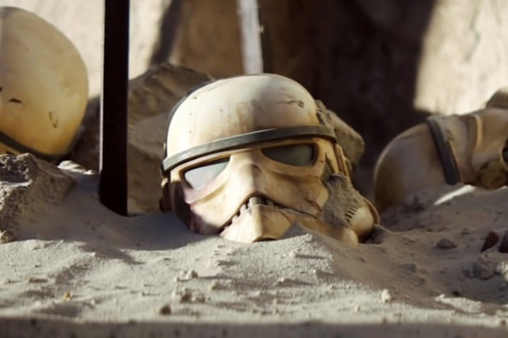 the mandalorian what you need to know star wars universe stormtrooper helmets in sand trailer