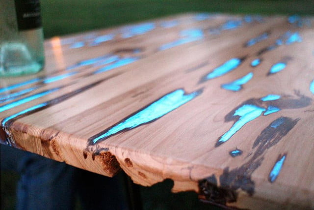 Photoluminescent resin makes this wooden table look like something out of Tron