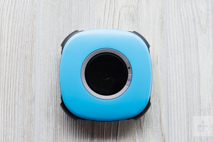 Vuze Camera sitting flat on a wood table