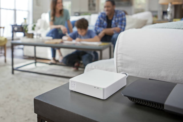 lowes iris professional monitoring hub in living room with family