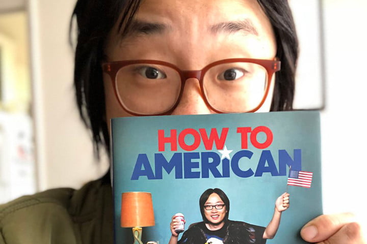 Jimmy O. Yang with book How to American