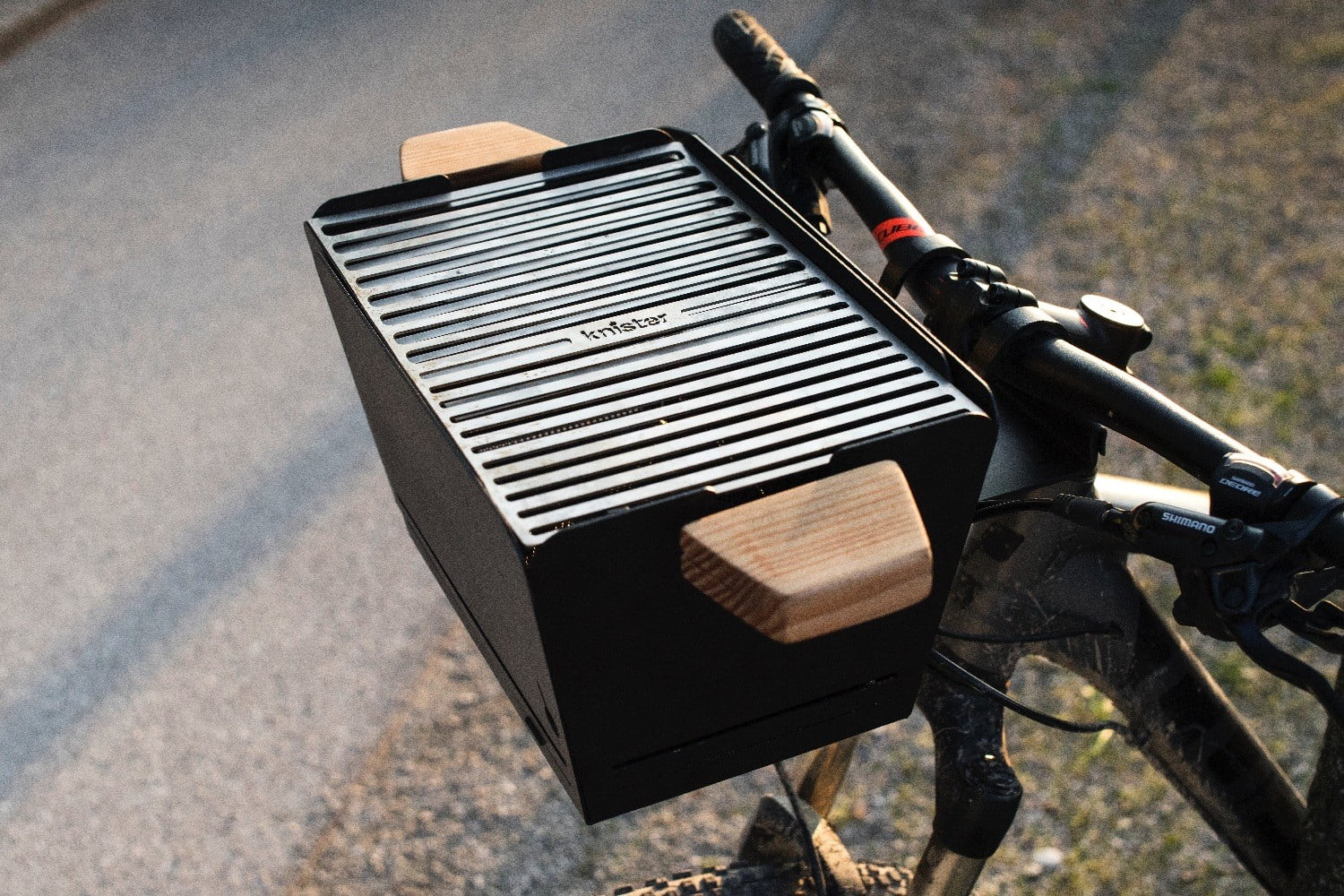 This portable grill transforms your bike into a rolling BBQ