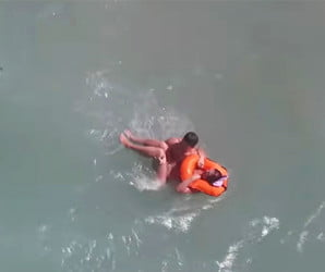 Watch as a 'lifeguard drone' rescues a swimmer struggling at sea