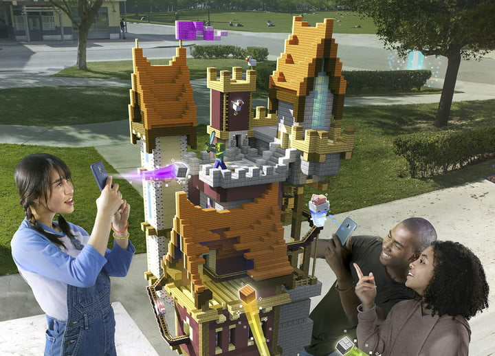 Players building a castle structure together in a park| Minecraft Earth Key Art