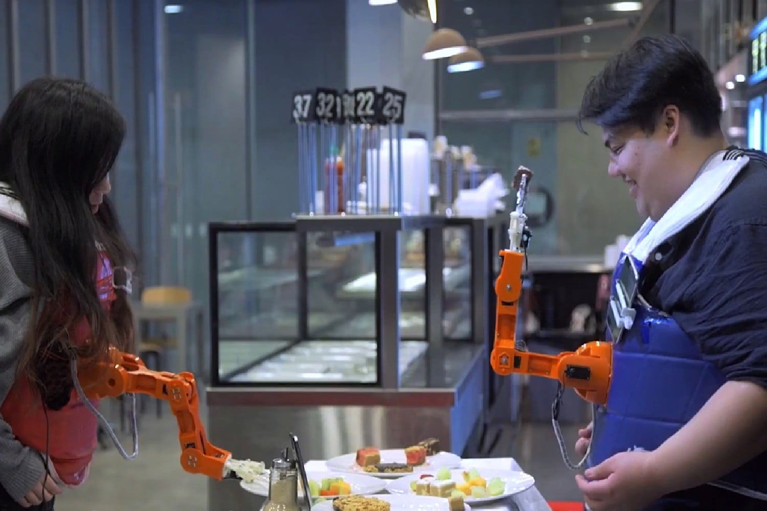This weird wearable robot arm will feed you and your dinner companion