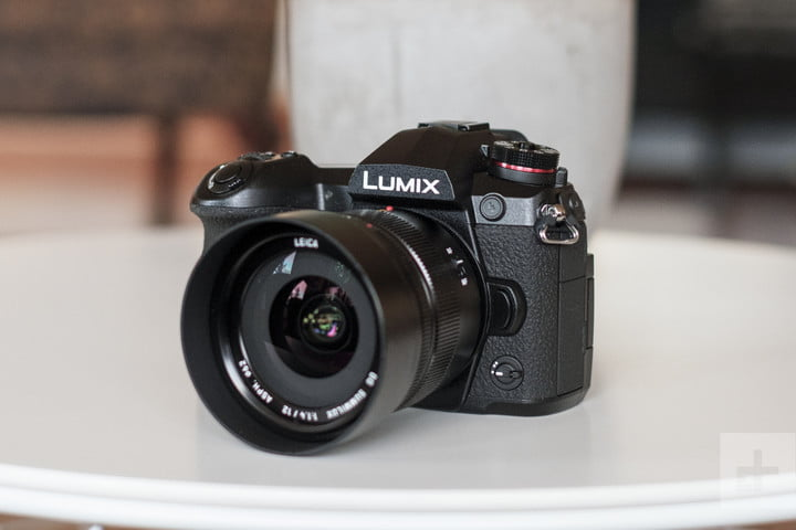 Panasonic Lumix G9 Review | Hero shot of the camera sitting on a white table facing the left side of the frame