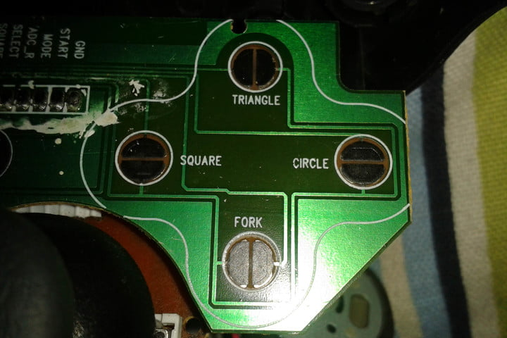 """PlayStation controller has a """"fork"""" button, and it has been there all along"""