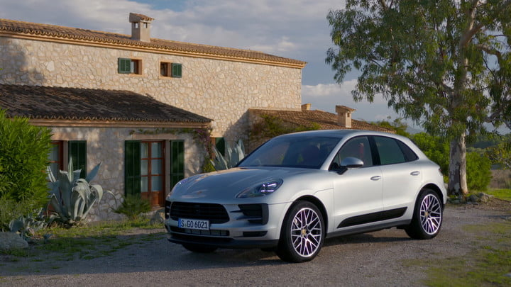 "The 2019 Porsche Macan S comes alive after the ""curves ahead"" sign"