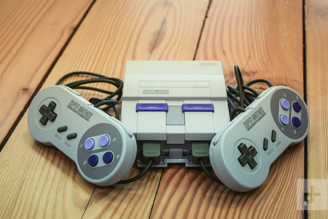 The SNES Classic Edition and both of its controllers laying against the corners
