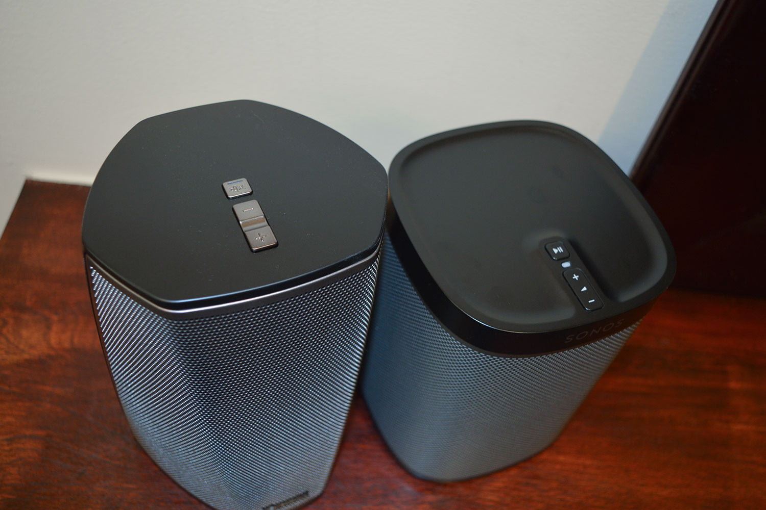 speakers like sonos. denon heos 1 (left) and sonos play:1 (right) speakers like
