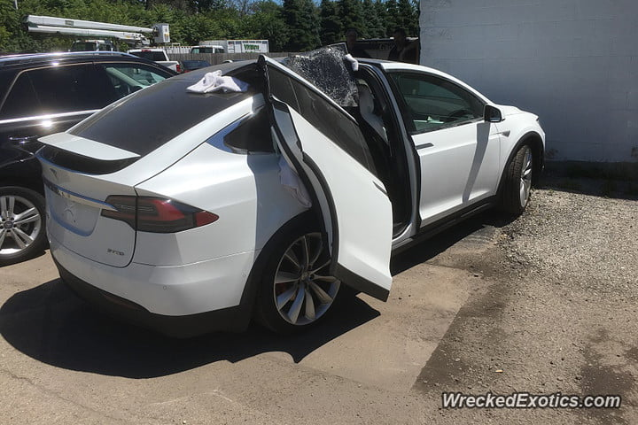 tesla model x falcon wing door ripped off with by garage 900x600 : falcon door - Pezcame.Com