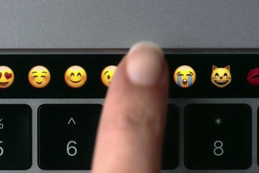 MacBook Pro Touch Bar Details: Runs watchOS, Retina display