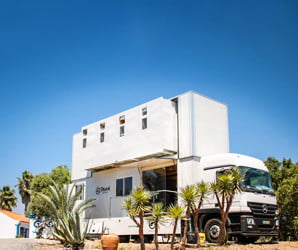 'Truck Hotel' is an amazing double-decker pad for surfers