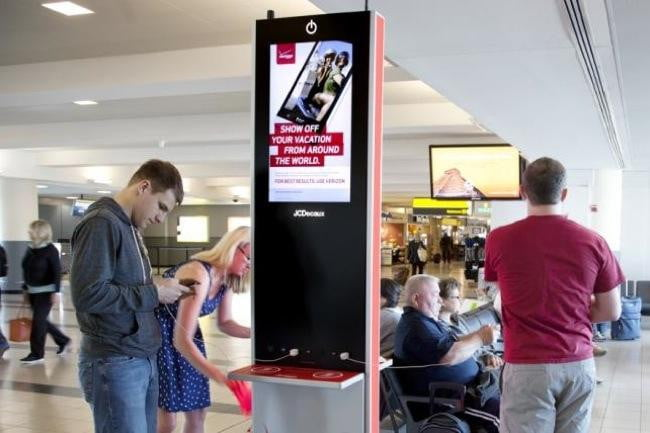 Qi wireless makes headway into hospitality digital trends verizon wireless advertising kiosks at airports double as charging stations there are four qi charging pads publicscrutiny Gallery